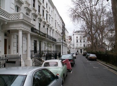 empty street with cars parked in London, England