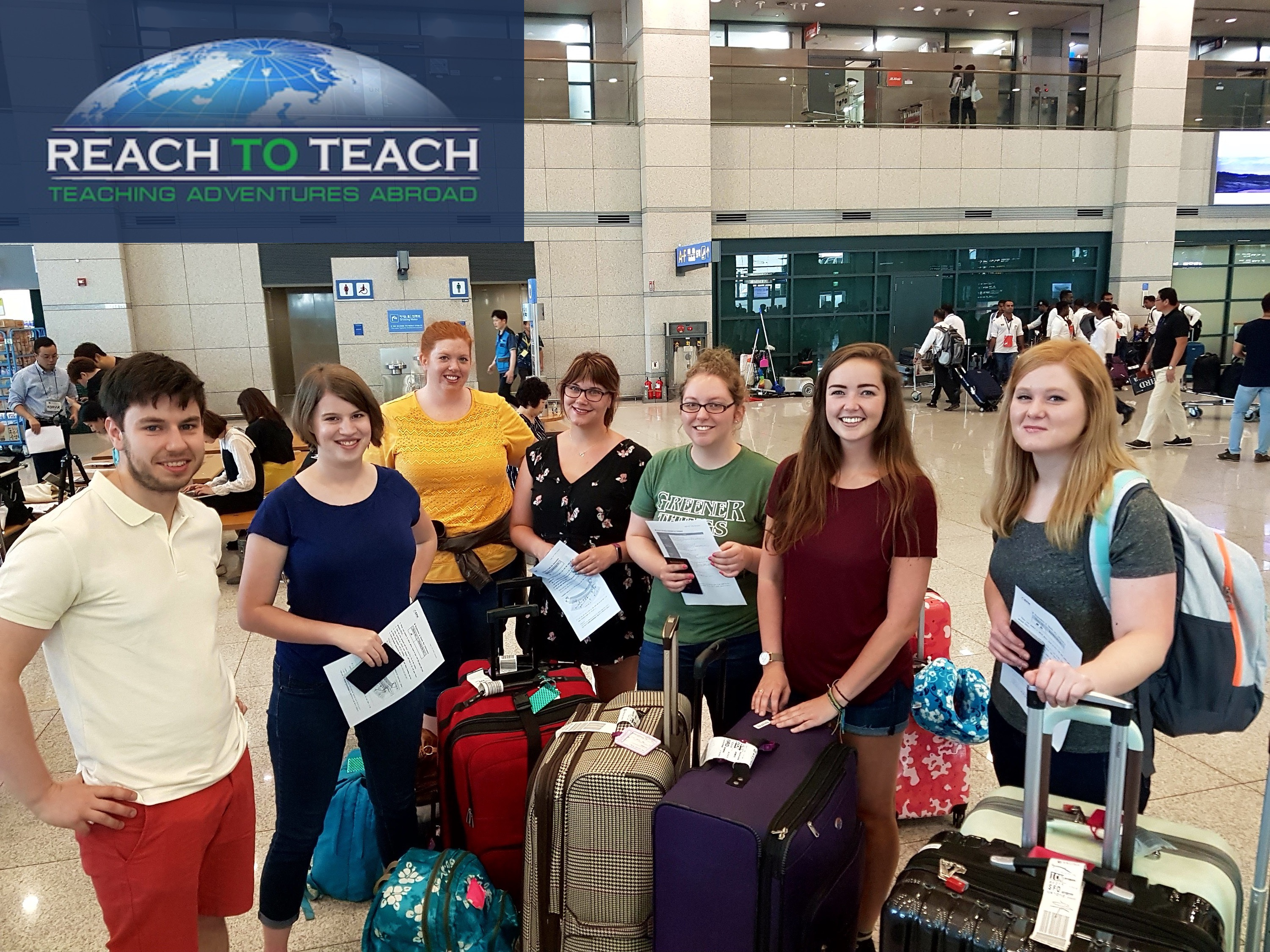 6 female and 1 male TEFL teacher in an airport arrival hall